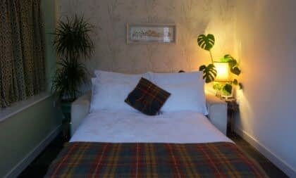 Bedroom in our lodge with a hot tub in Ballater
